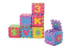 Foam puzzle letter cubes. Isolated on a white background Royalty Free Stock Photos