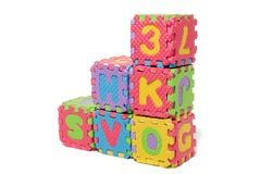 Foam puzzle letter cubes. Isolated on a white background Stock Image