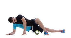 Foam Roller Exercises. Foam roller exercise explanation and execution with a trainer Royalty Free Stock Image