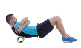 Foam Roller Exercises. Foam roller exercise explanation and execution with a trainer Stock Photo