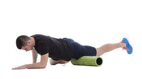 Foam Roller Exercises. Foam roller exercise explanation and execution with a trainer Royalty Free Stock Images