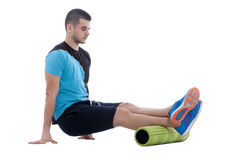 Foam Roller Exercises. Foam roller exercise explanation and execution with a trainer stock images