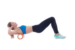 Foam Roller Exercises. Foam roller exercise explanation and execution with a trainer stock photography