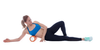 Foam Roller Exercises. Foam roller exercise explanation and execution with a trainer Stock Photos
