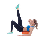 Foam Roller Exercises. Foam roller exercise explanation and execution with a trainer Royalty Free Stock Photography