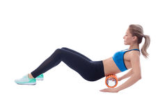 Foam Roller Exercises. Foam roller exercise explanation and execution with a trainer royalty free stock photo