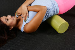 Foam Roller. Woman using a foam roller after a workout royalty free stock photos