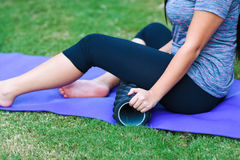 Foam Roller. Woman using a foam roller after a workout stock images