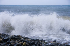 Foam Sea. Wave with splashes of flying on the beach. Storm on the sea stock photos