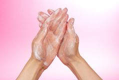 Foam of soap on female hands Stock Photos