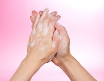Foam of soap and female hands Stock Photography