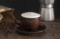 Foam Topped Coffee. On a Wooden Table royalty free stock photography