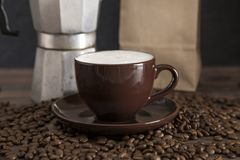 Foam Topped Coffee. On a Wooden Table royalty free stock photos