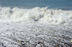 Foam of water and  waves of surf on the sea. Coastline Stock Photo