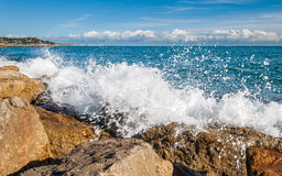 Foam waves. Sea views next the beach and the breakwater Royalty Free Stock Photo
