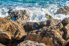 Foam waves. Sea views next the beach and the breakwater Royalty Free Stock Image