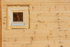 Foam window insulation on wooden construction. Building an eco-house. Heat insulation. Royalty Free Stock Image