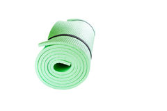 Foam Yoga Mat roll isolated on white Stock Photography