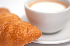 Foamed cappuccino and a croissant Stock Photo