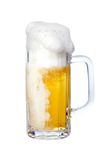 Foaming beer. In mug, isolated on white Royalty Free Stock Image