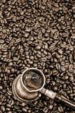 Foaming coffee, sepia Royalty Free Stock Photo