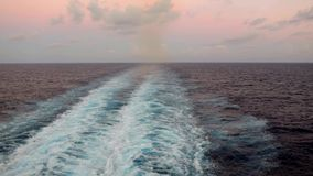 Foaming ocean water after cruise ship during sunset stock video