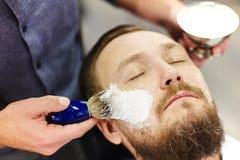 Foaming shaving cream Stock Photography