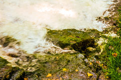 Foaming Water over Rocks. On the side of a river stock image