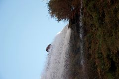 Foaming water plunging over a cliff edge royalty free stock images