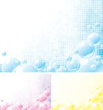 Foamy backgrounds. Three Vector abstract backgrounds with many blue, yellow and pink bubbles Stock Photos
