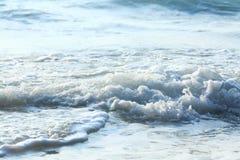 Foamy blue sea wave Stock Images