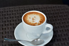 Foamy Cappuccino With Smile on A Black Background Royalty Free Stock Photography