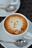 Foamy Cappuccino With Smile on A Black Background Royalty Free Stock Photo