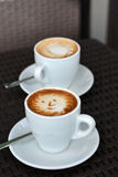 Foamy Cappuccino With Smile on A Black Background Royalty Free Stock Images