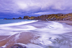 Foamy circles. Sandy beach near Midfields on the north coast of Scotland Royalty Free Stock Photo