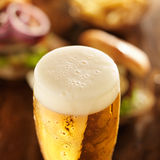 Foamy cold glass of beer royalty free stock photo