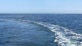 The foamy fareway on the Black sea surface in summer