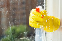 Foamy liquid on window glass during washing Royalty Free Stock Photos