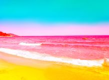 Free Foamy Rippled Pink Sea Wave Rolling To Yellow Sand Shore. Turquoise Blue Sky. Beautiful Toned Image With Bright Neon Colors Stock Photos - 141659833