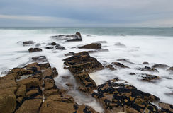Foamy rocks in Brittany Stock Images