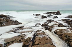 Foamy rocks in Brittany Stock Image