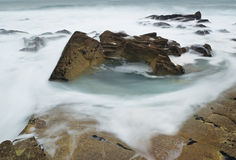 Foamy rocks in Brittany Royalty Free Stock Photography