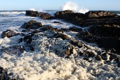 Foamy Sea and Rocks Stock Photography