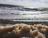 Foamy sea. Suffolk Coast. Stock Photos