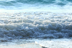 Foamy sea wave on coast Stock Photography