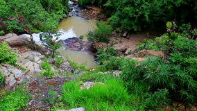 Foamy Stormy Mountain River Flows among Large Rocks stock footage