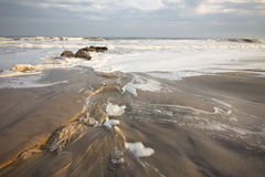 Foamy Surf. On the rocks as storm approaches Stock Image