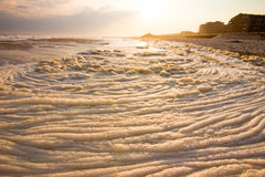 Foamy Surf. As the sunsets Stock Images