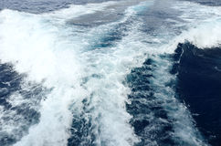 Foamy trace. Foamy wake behind the stern of the ship Stock Image