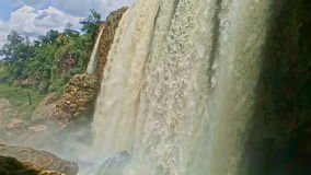 Foamy Wall of Wide Powerful Waterfall among Rocks. Foamy water wall of wide powerful waterfall among rocks in tropical national park stock video
